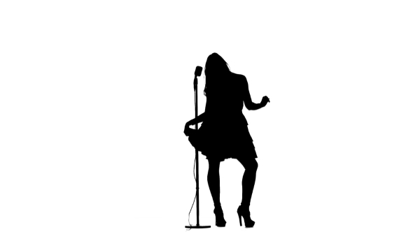 590x332 Silhouette Of Singer Performimg Songs In A Retro Microphone