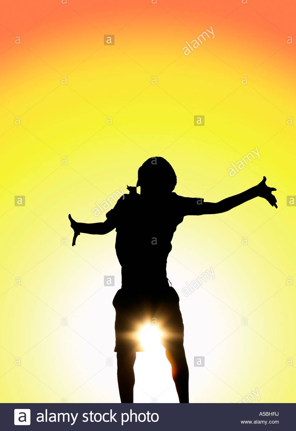 954x1390 Silhouette Indian Boy In Joyful Playful Mood Shot Against A Sunset