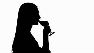 320x180 Girl Drinking White Wine With Glasses. Silhouette. Close Up Stock