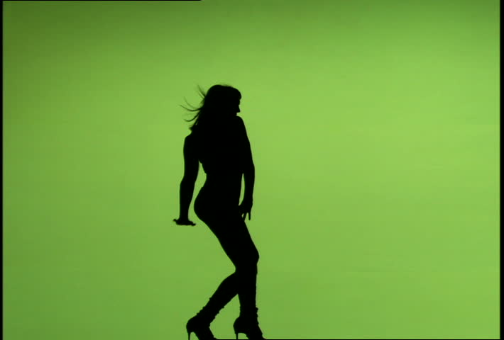 710x480 Woman's Silhouette Dancing Against A Green Screen Background Stock