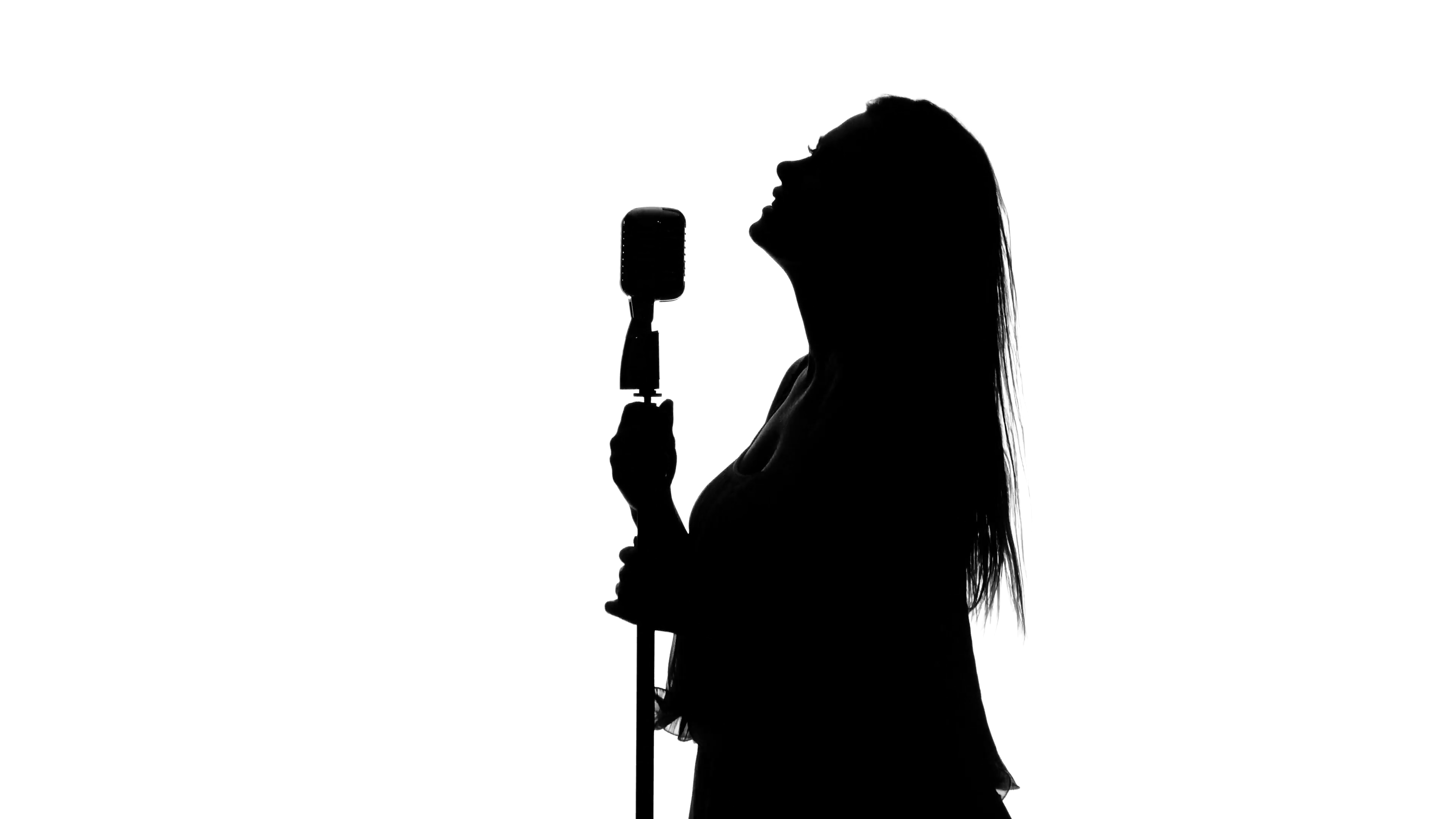 3840x2160 Singer Sings The Song With A Microphone. White. Silhouette Stock
