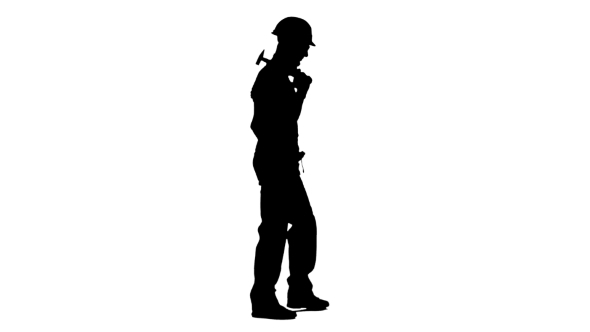 590x332 Silhouette Of Man Builder With Hammer In His Hands Goes To