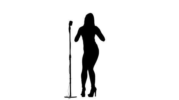 590x332 Silhouette Of Girl Singing A Song And Dancing Near A Retro