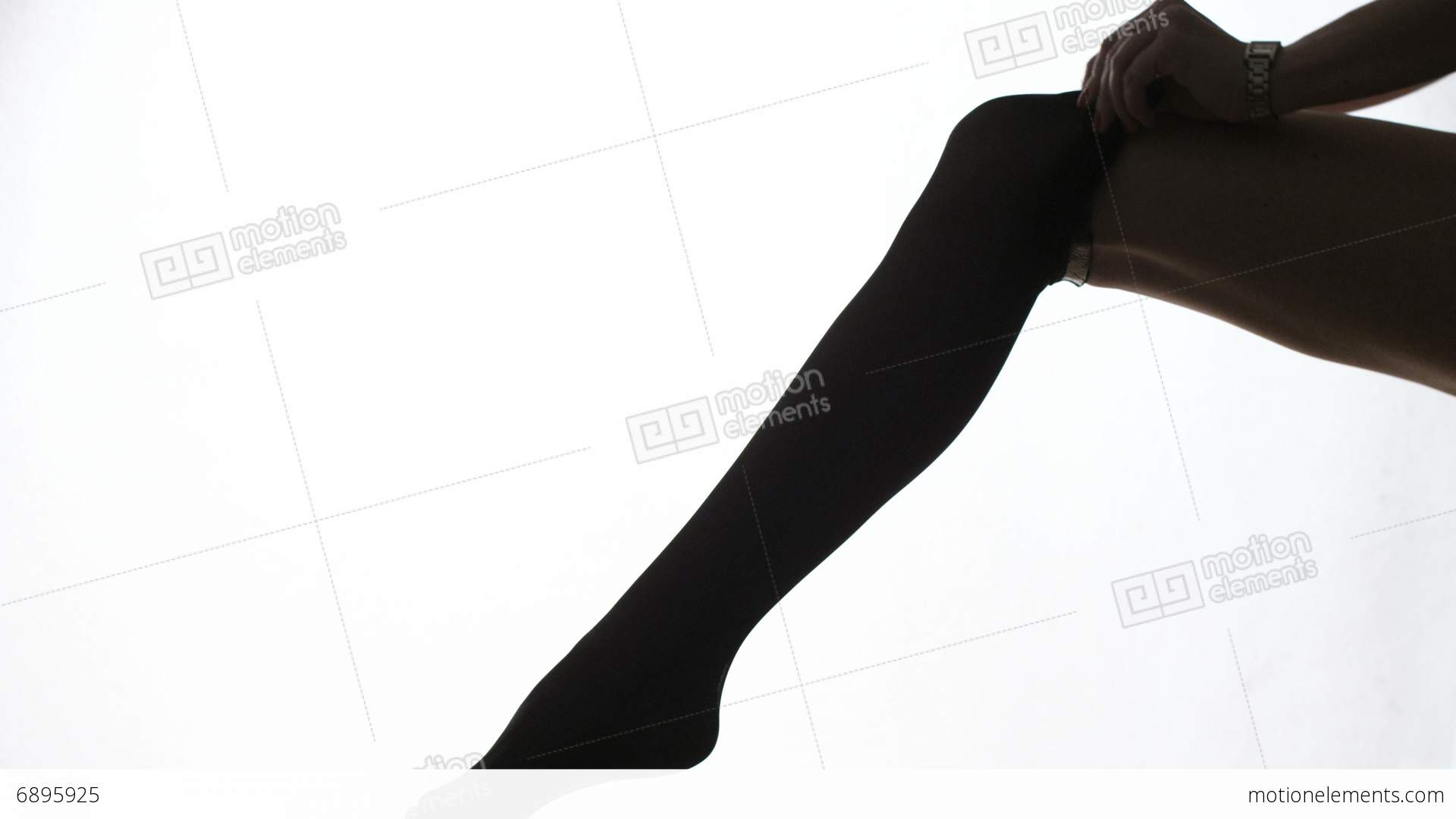 1920x1080 Lady Puts On Stockings In Silhouette Stock Video Footage 6895925