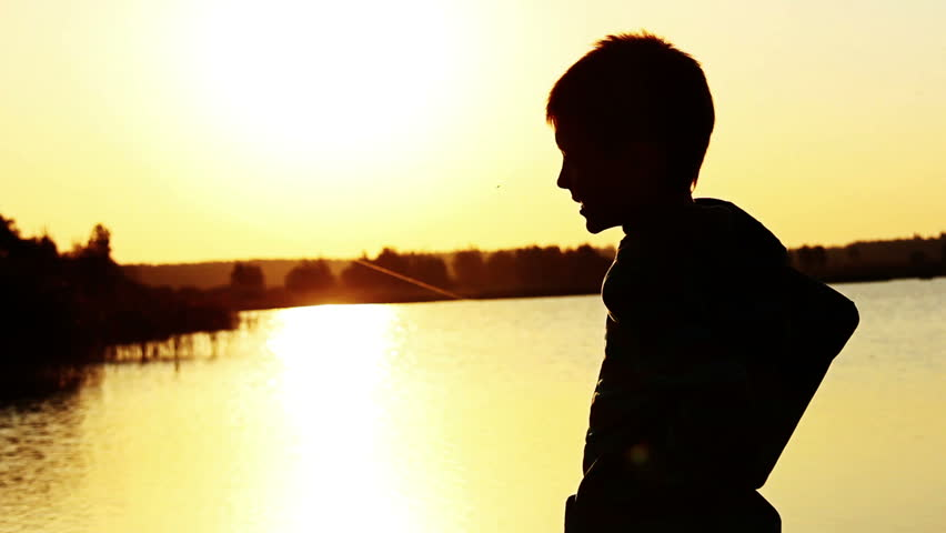 852x480 Young Guy Near Wide River And Far Away City, Silhouette Against