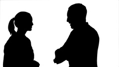 240x135 MS Silhouette of two businessmen talking and pointing to white