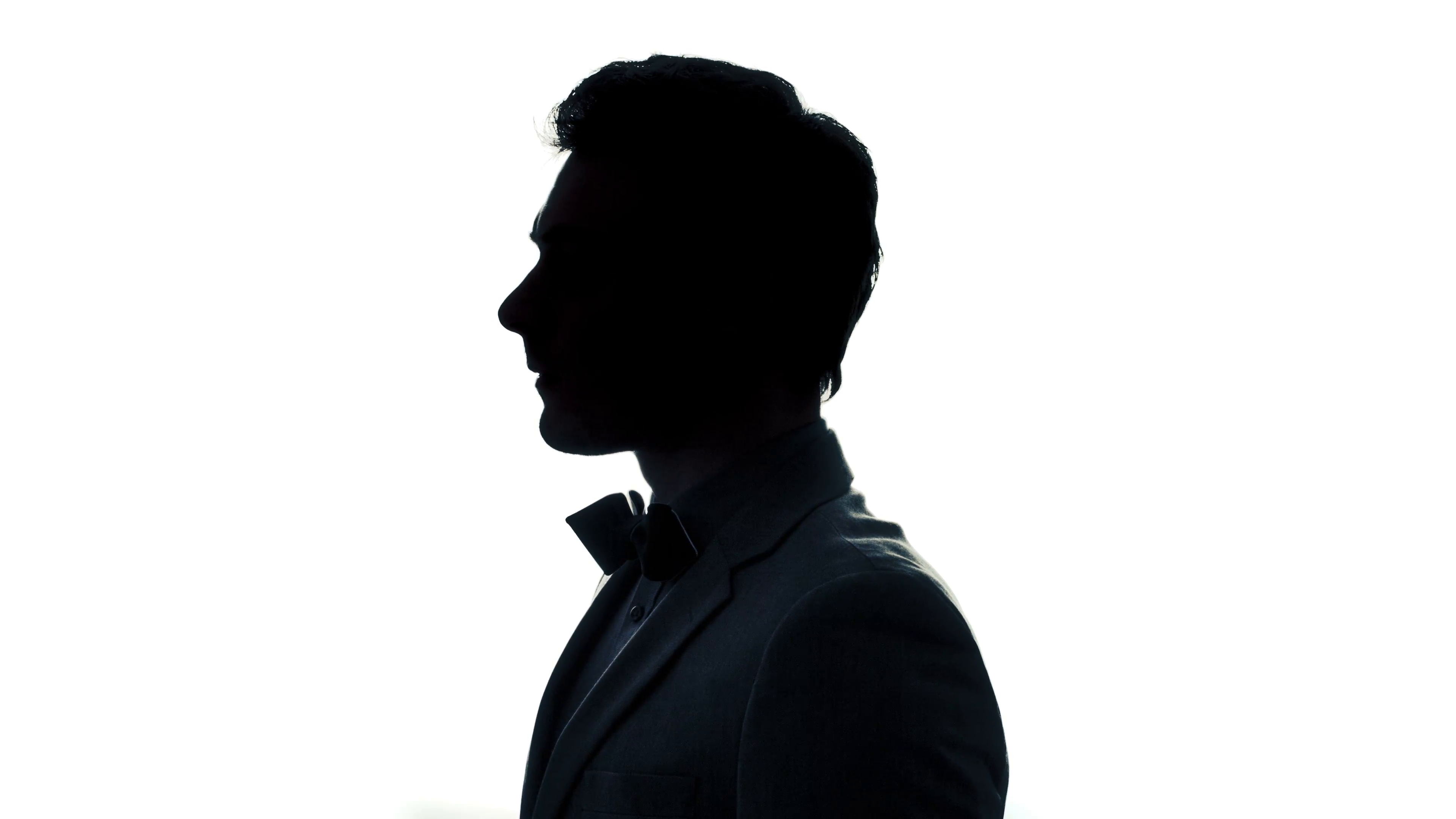 3840x2160 Well Dressed Young Man With A Classic Bow Tie In Silhouette Stock