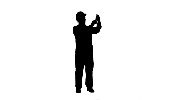590x332 Silhouette Construction Engineer In Helmet Makes Selfie On