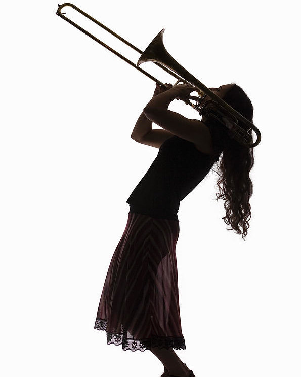 595x743 Silhouette Of Female Trombone Player Poster By Pm Images