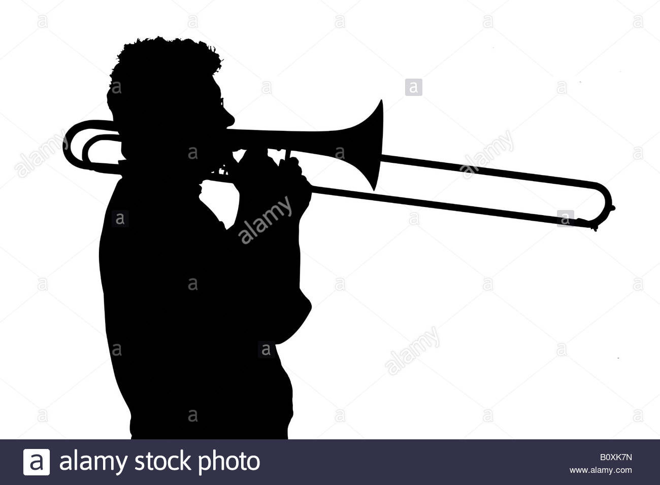 1300x956 Silhouette Of A Man Playing The Trombone Stock Photo 17796233