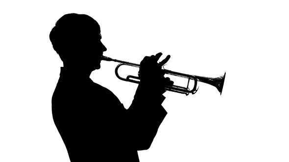 590x332 Silhouette. Musician Slowly Playing Trumpet In A Studio By Kinomaster