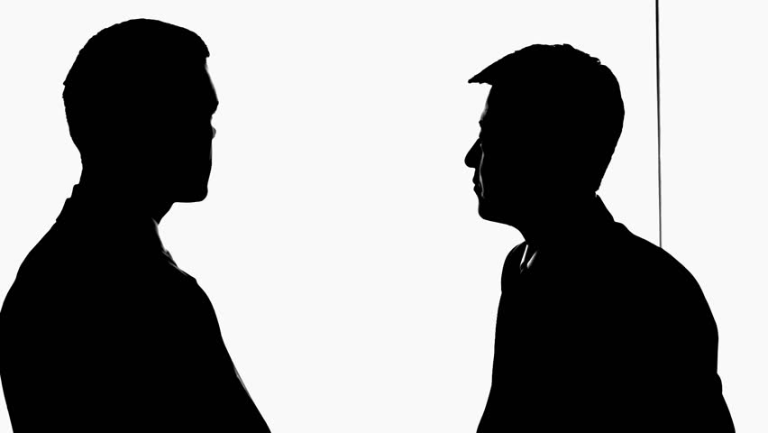 852x480 Silhouette Two Medical Professionals Discuss With A Patient. Stock