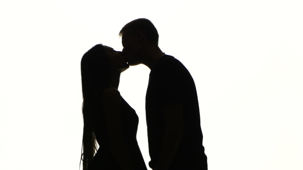 590x332 Portrait Of Two People Kissing. Silhouette. White By Kinomaster