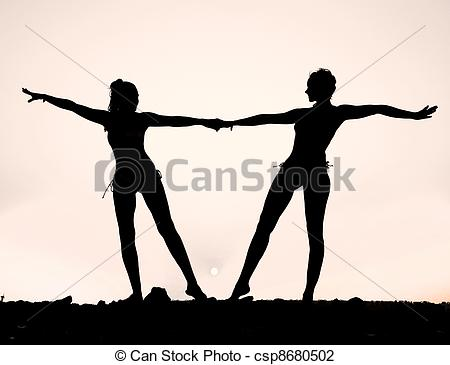 450x365 Silhouette Of Two Young Women Against The Evening Sunset Stock