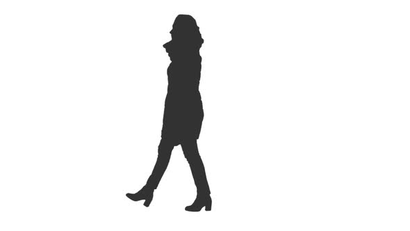 590x332 Silhouette Of A Young Woman Walking In The Street, Alpha Channel