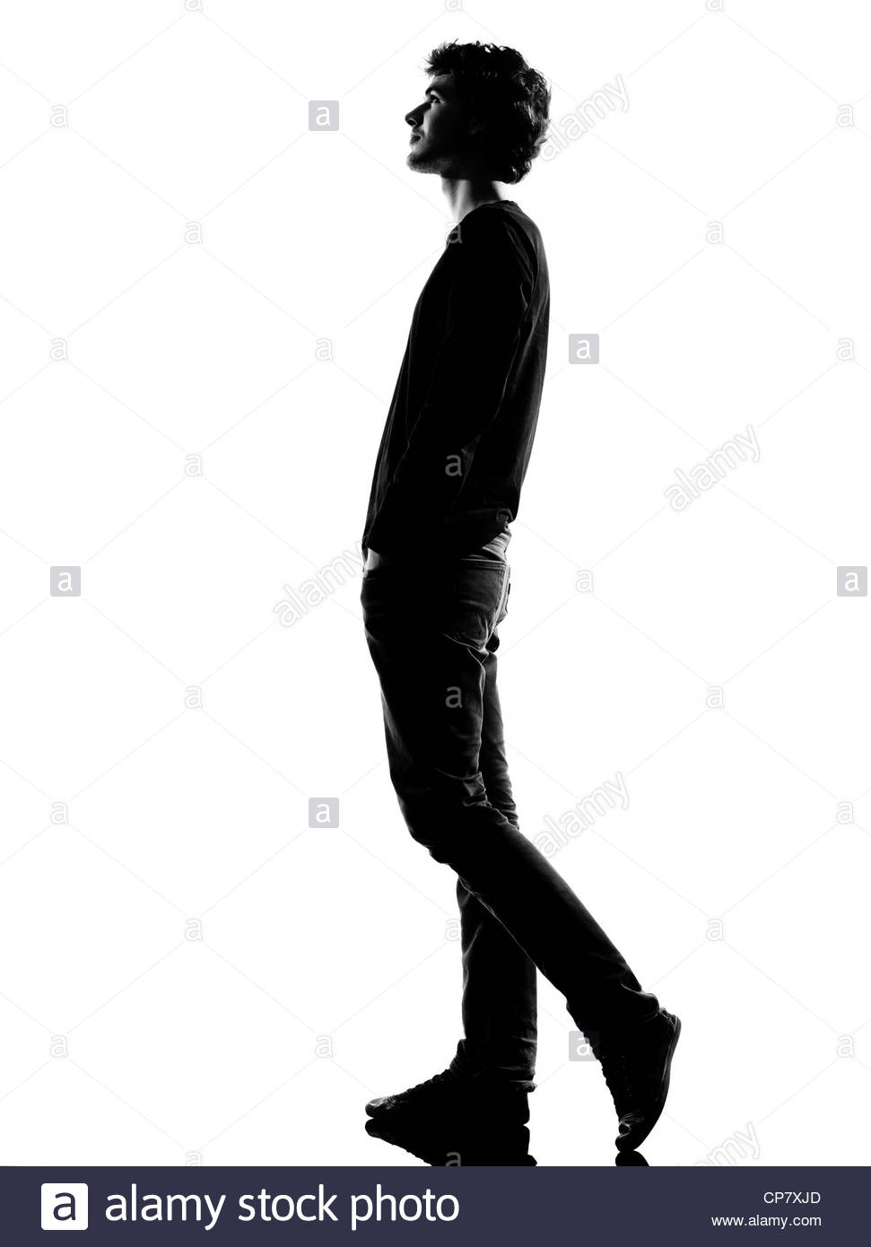 971x1390 Young Man Walking Silhouette In Studio Isolated On White