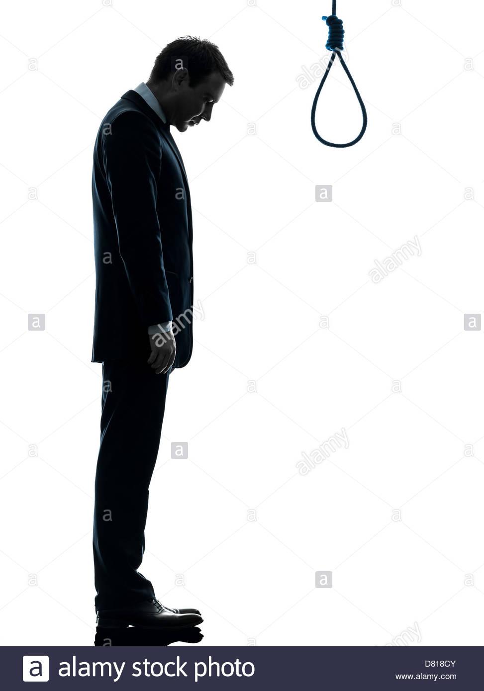973x1390 One Man Standing In Front Of Hangman's Noose In Silhouette Studio