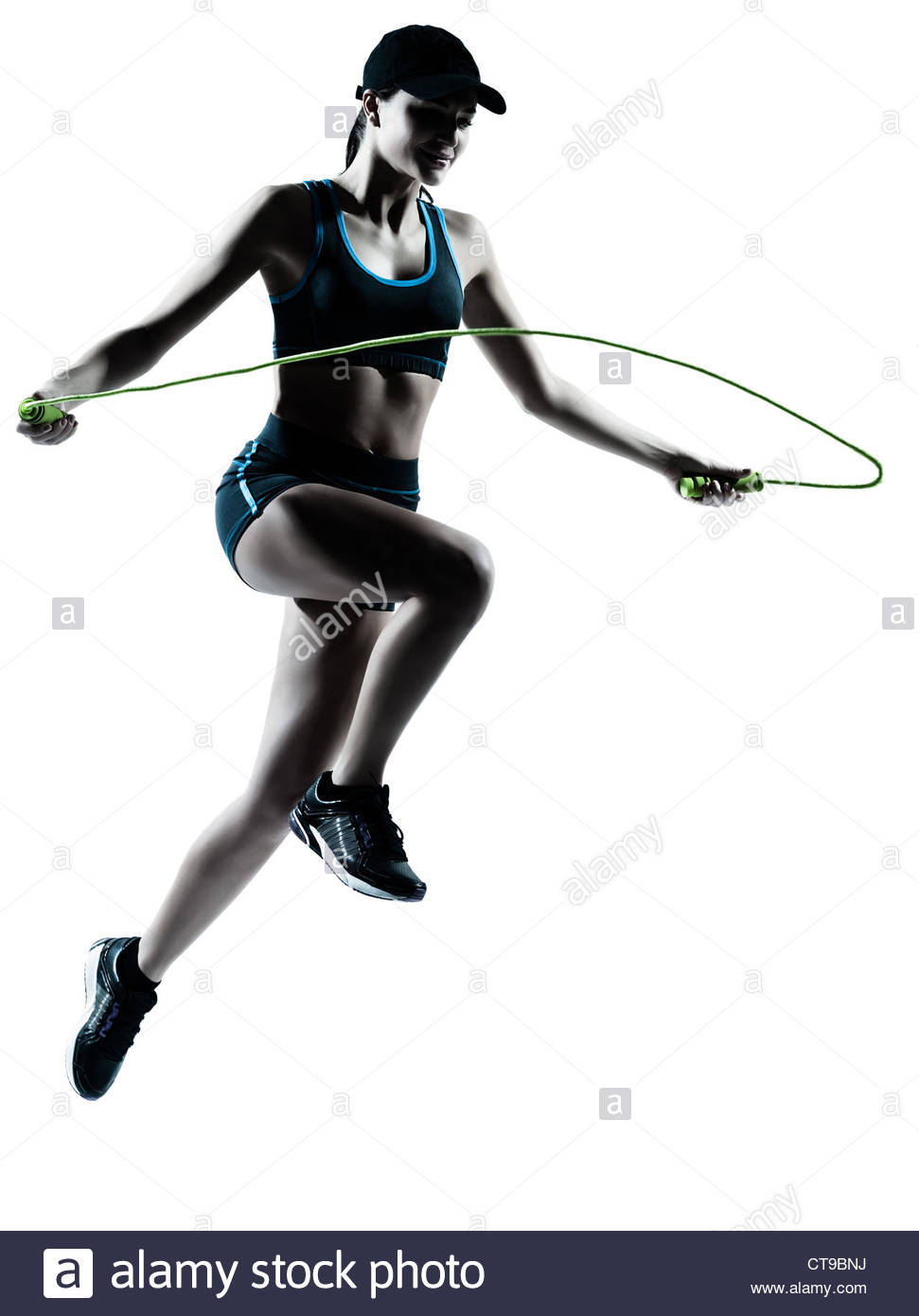 971x1390 One Caucasian Woman Runner Jogger Jumping Rope In Silhouette