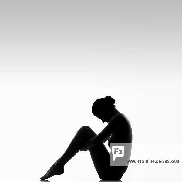 600x600 Silhouette Of A Woman Sitting Mydrlynx
