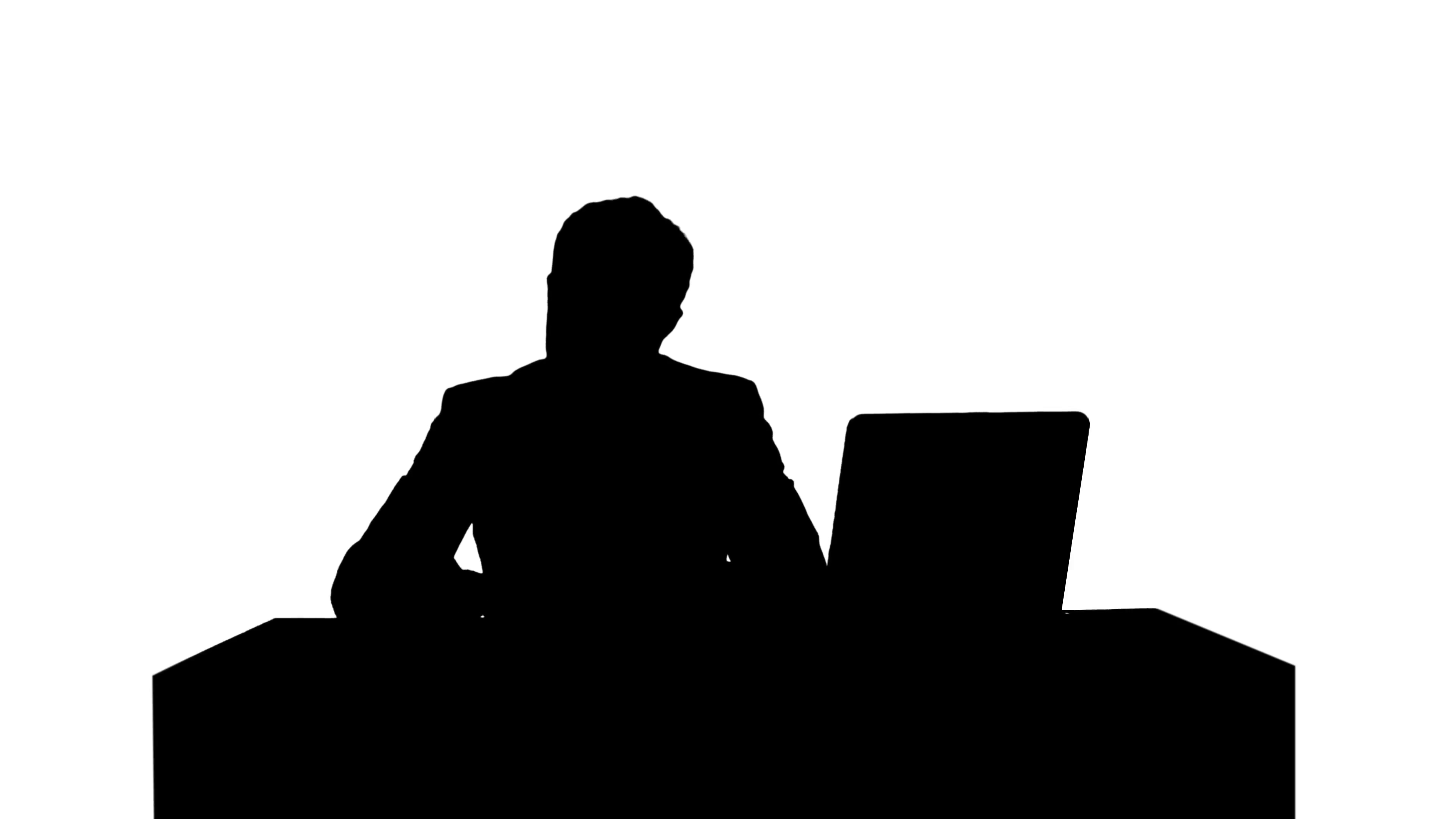 3840x2160 Silhouette Human Hand Writing On A Paper With Laptop Stock Video