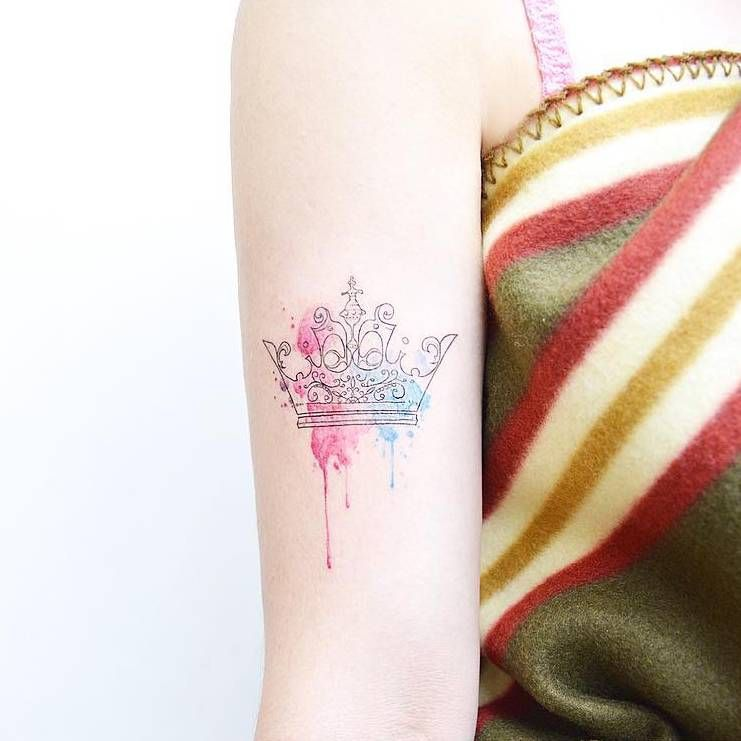 741x741 Fine Line And Watercolor Crown Tattoo On The Right Bicep