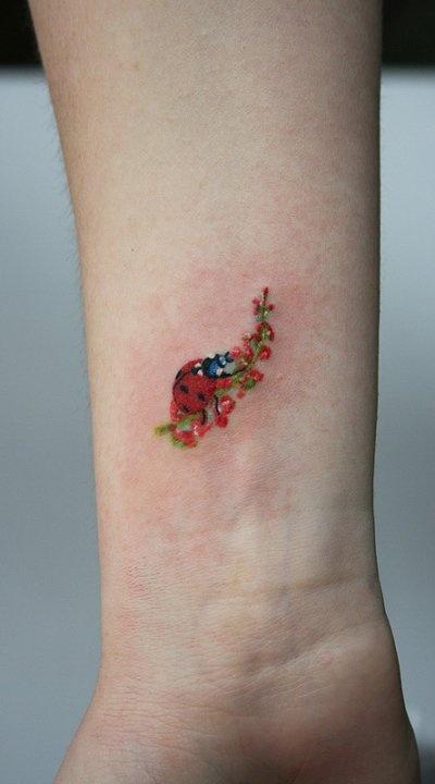 Watercolor Ladybug Tattoo